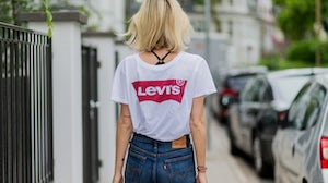 """The Levi's """"batwing"""" logo T-shirt has become a common sight on city streets worldwide.   Source: Getty Images/Christian Vierig"""