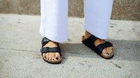 A women wearing Birkenstock's Arizona shoes during Milan Fashion Week | Source: Getty Images