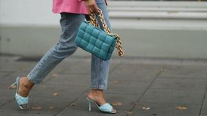 A fashion week attendee wears Bottega Veneta shoes and a handbag. Getty Images.