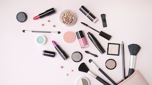 Makeup bag with beauty products. Shutterstock.
