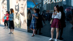 Consumers outside Prada's store in the IFS shopping district. Shutterstock
