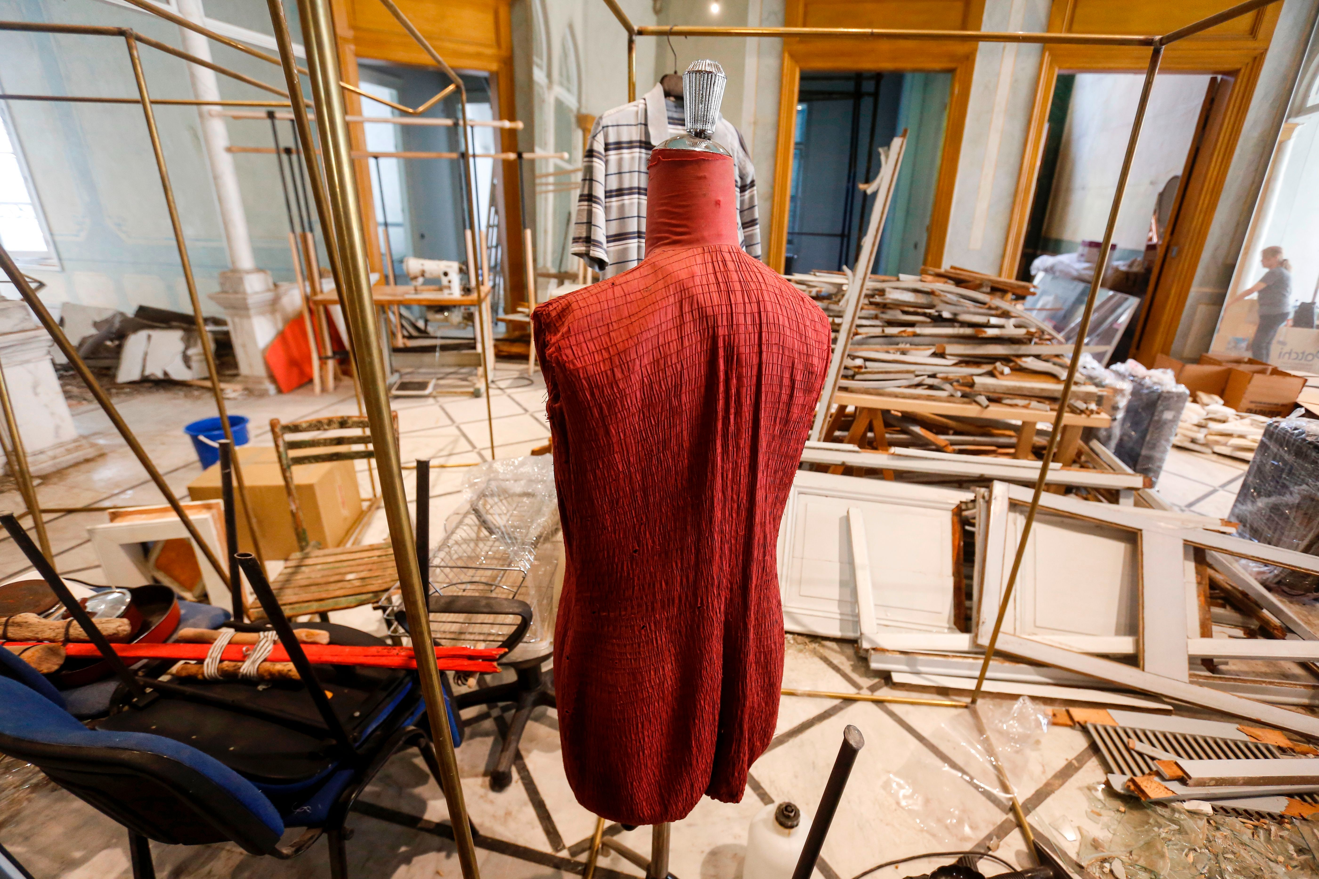 A fashion dummy stands amidst destruction at the Maison Rabih Kayrouz, flagship atelier of designer Rabih Kayrouz, housed in the 19th-century Dagher Palace in Beirut's trendy Gemmayzeh district. Getty Images.