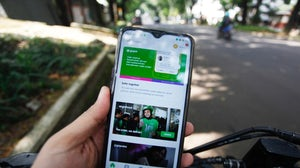 A person using the Gojek app. Getty Images.