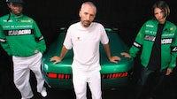 Arthur Kar and models wear his new collaboration for Porsche, alongside the 968 L'Art model. L'Art De L'Automobile