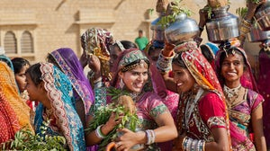 Young women dressed in traditional indian sari at the Desert Festival on March 1, 2015. Shutterstock.