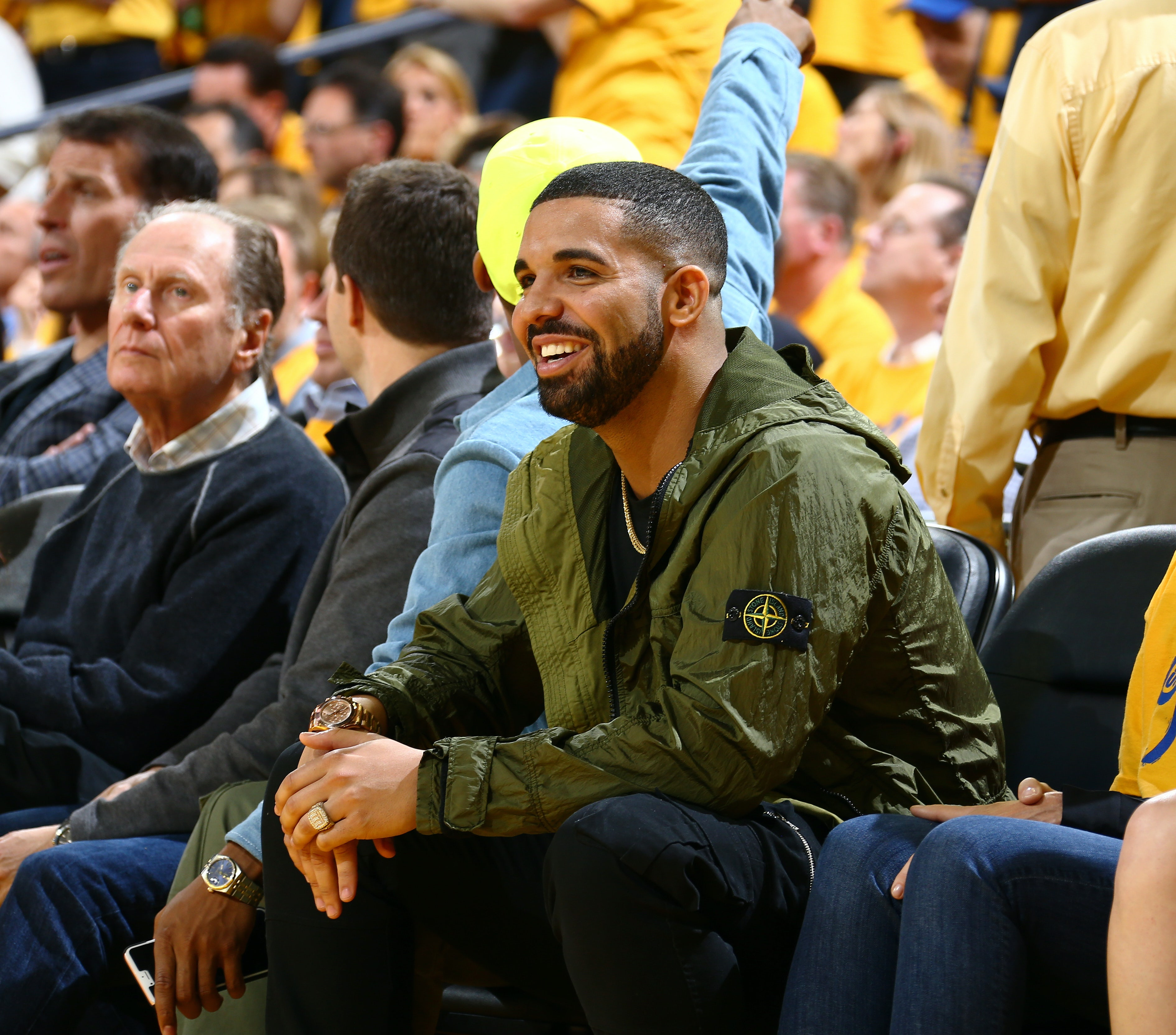 Canadian rapper Drake, one of Stone Island and Moncler's most prominent clients, attends the 2016 NBA finals wearing Stone Island. Getty Images.