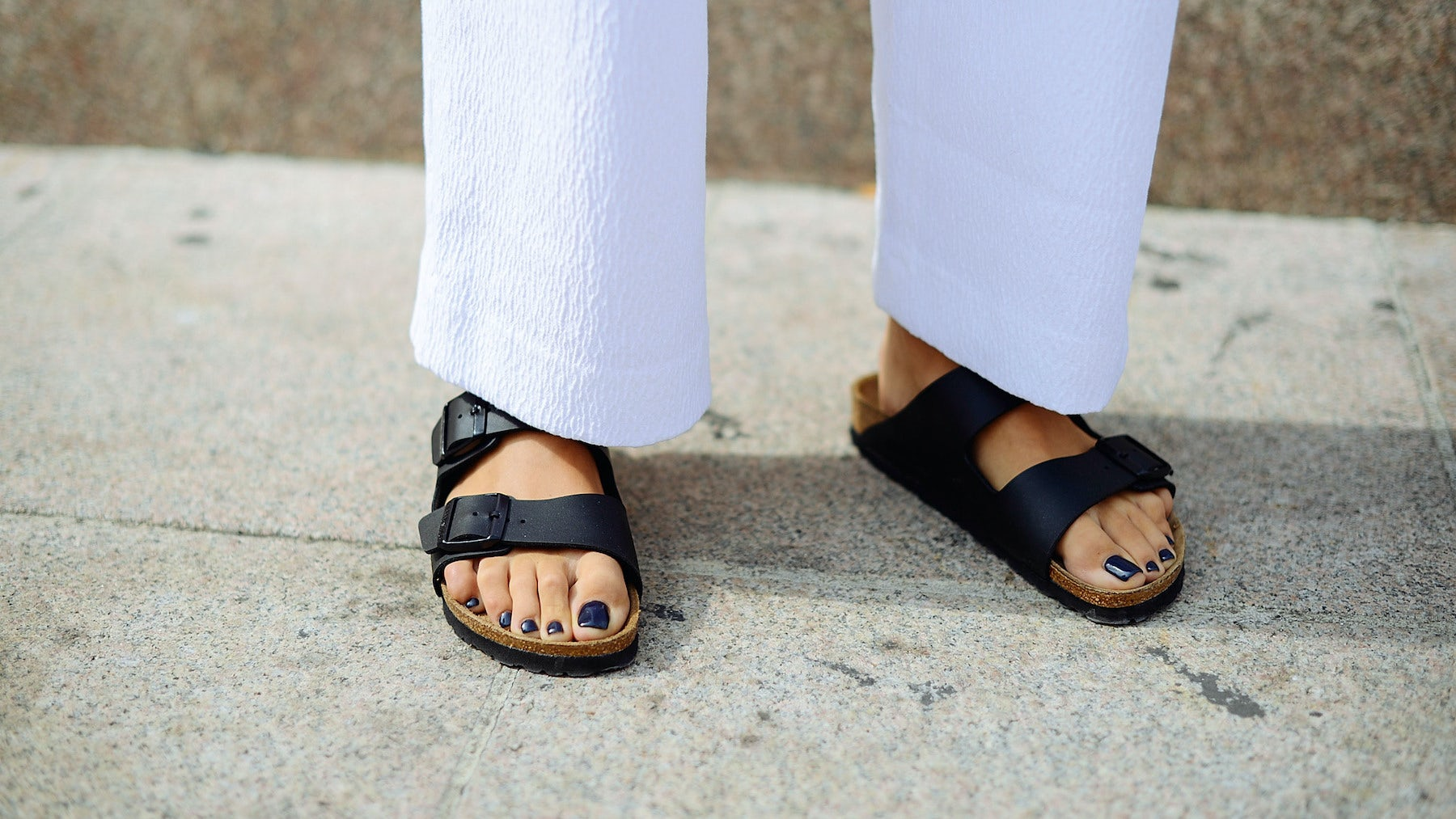 A women wearing Birkenstock\'s Arizona shoes during Milan Fashion Week. Getty Images.