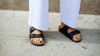 A women wearing Birkenstock's Arizona shoes during Milan Fashion Week. Getty Images.