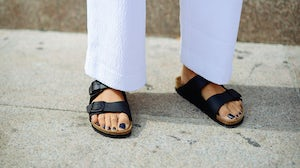 A women wearing Birkenstock's Arizona shoes during Milan Fashion Week. Getty Images.