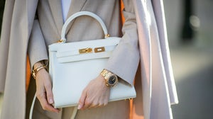 Blogger Alexandra Lapp wears a white Kelly handbag and Rolex watch in Dusseldorf, Germany. Getty.