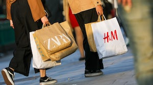 Shoppers carry Zara and H&M bags in London, UK. Getty Images.