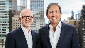 In September 2022, former Coach CEO Joshua Schulman (left) will take the helm at Michael Kors parent company Capri, as current CEO John D. Idol (right) transitions to the role of Executive Chairman. Capri Holdings.