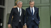 Sidney Toledano and Bernard Arnault arrive at an hommage ceremony for Karl Lagerfeld Homage at the Grand Palais in June 2019. Getty Images.