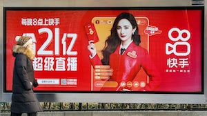 A billboard advertising Chinese short video app Kuaishou in Beijing, China. Getty Images.