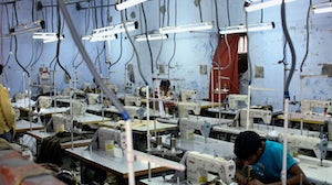 India's garment factories are operating at lower capacity as country battles deadly second wave. Shutterstock