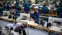 In early 2021, garment factories in Vietnam pivoted to making masks. But now, amid an overwhelming uptick in Covid-19 cases, factories have been shut altogether. Getty Images.