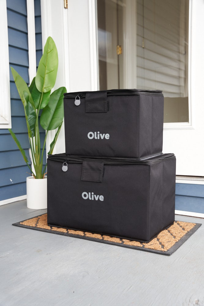 Olive consolidates customers\' e-commerce orders for delivery in reusable totes. Olive.