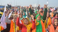 Farmers raise slogans during the ongoing protest against the new farm laws at Ghazipur in January 2021. Getty Images.
