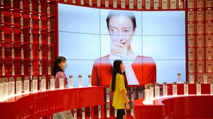 Customers purchase cosmetics at a duty-free shop in Hainan, China. Getty Images.