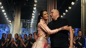 Padma Lakshmi with designer Tarun Tahiliani at Lakme Fashion Week. Getty Images