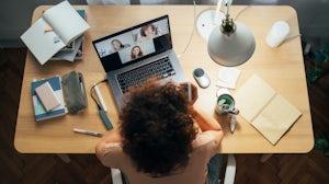 Employee Balancing Hybrid Working. Getty Images.