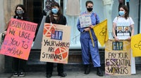 Activists hold placards during a demonstration in London's Regent Street. Getty Images.