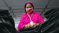 A garment worker in Dhaka, Bangladesh. Getty Images.