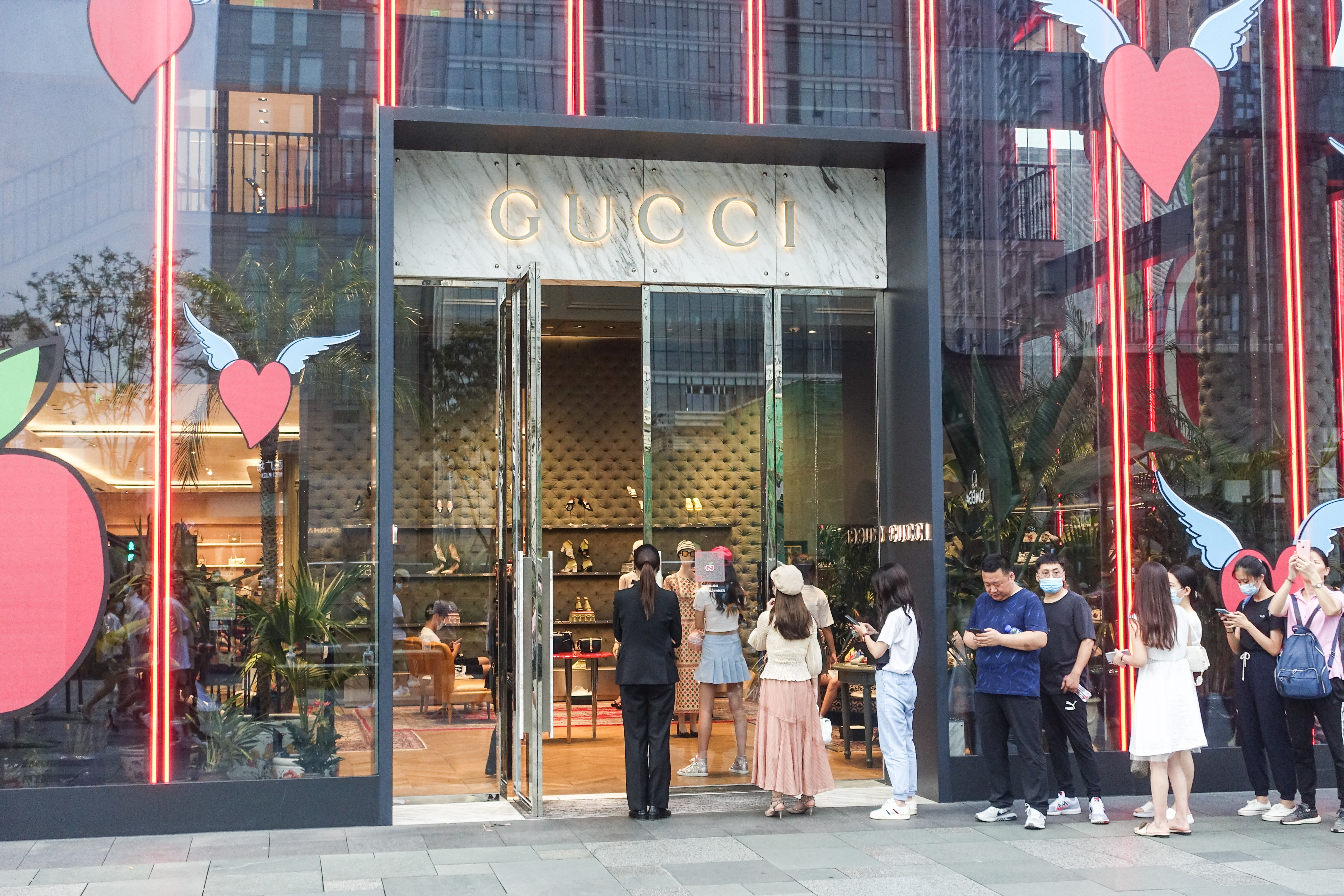 A long line of customers outside the Gucci store in Chengdu\'s International Finance Square. Getty Images.