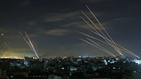 Israel's Iron Dome missile defence system intercepts rockets fired by Hamas towards Israel, days into a conflict during which Israel has bombarded the Gaza Striip. Mohammed Abed/AFP via Getty Images.