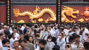 Chinese travellers over the Labour Day holiday. China News Service