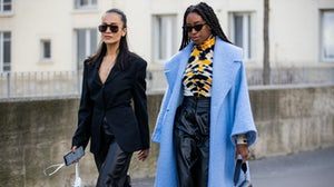 Anna Rosa Vitiello wearing white Loewe bag with fringes and Chrissy Rutherford is seen wearing blue coat, turtleneck with print, Wandler bag, black high waist leather pants outside Elie Saab during Paris Fashion Week Autumn/Winter 2020/2021. Getty Images