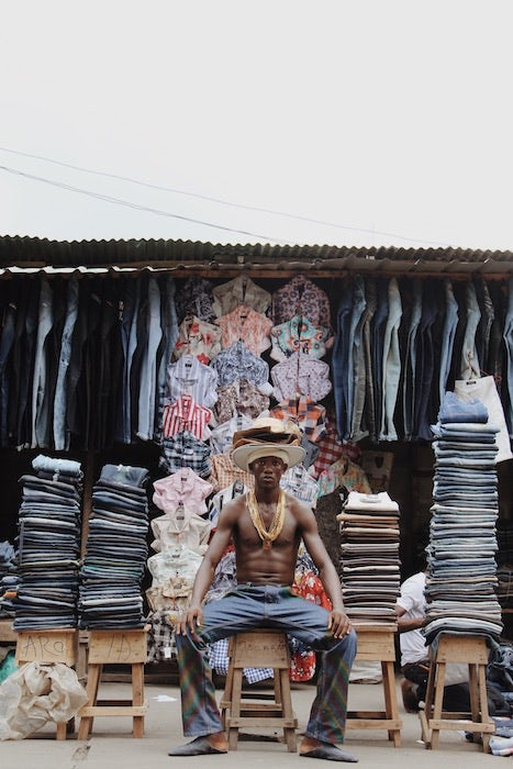 Portrait taken in Lagos\' Idumota market by Stephen Tayo.