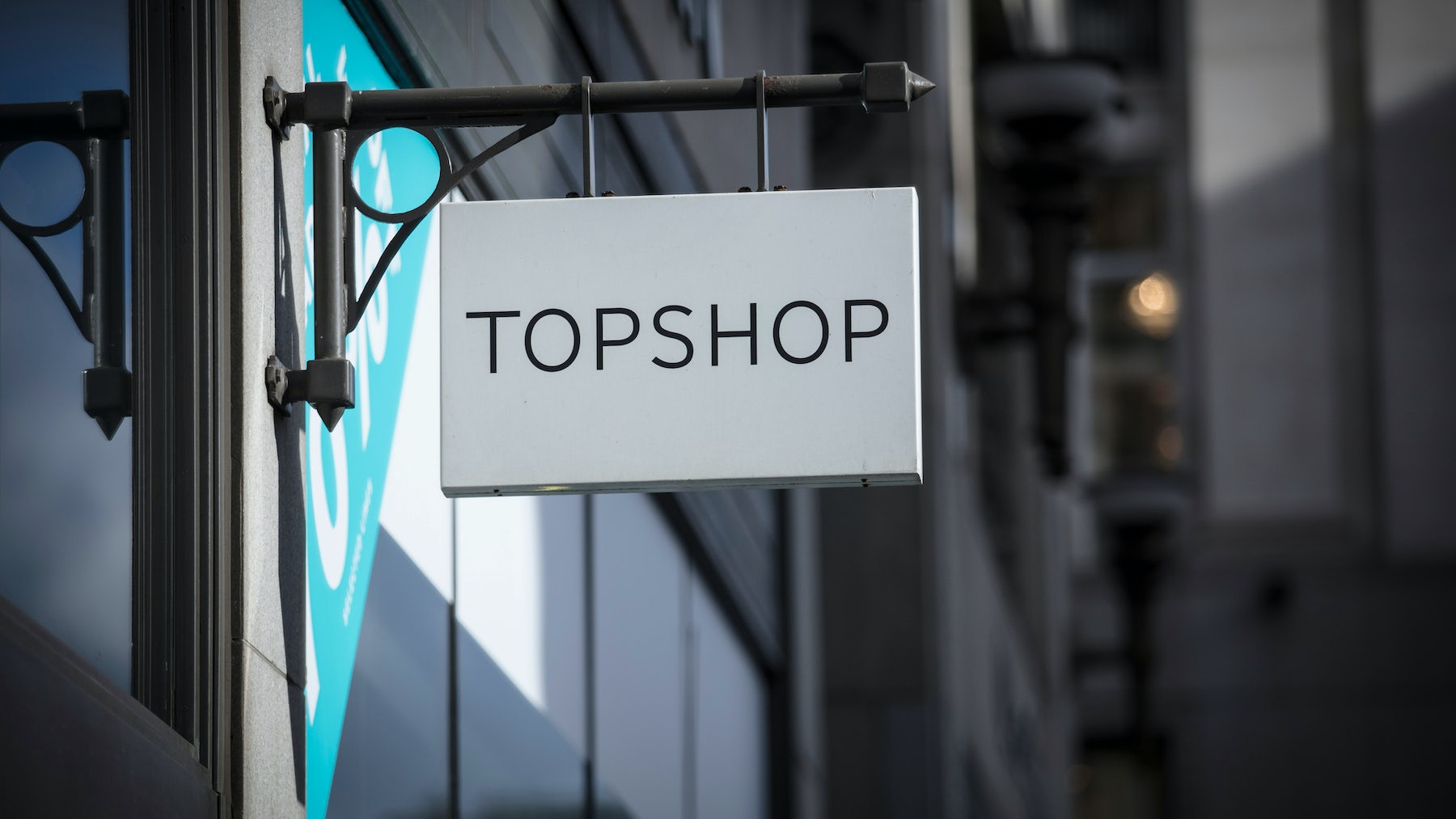 A sign and logo for Topshop store. Shutterstock.