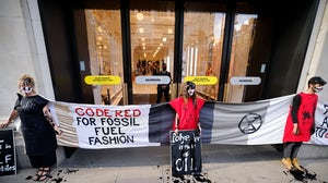 Activists from the Extinction Rebellion demonstrate outside Selfridges store in central London on August 24, 2021 during the group's 'Impossible Rebellion' series of actions. Getty Images.