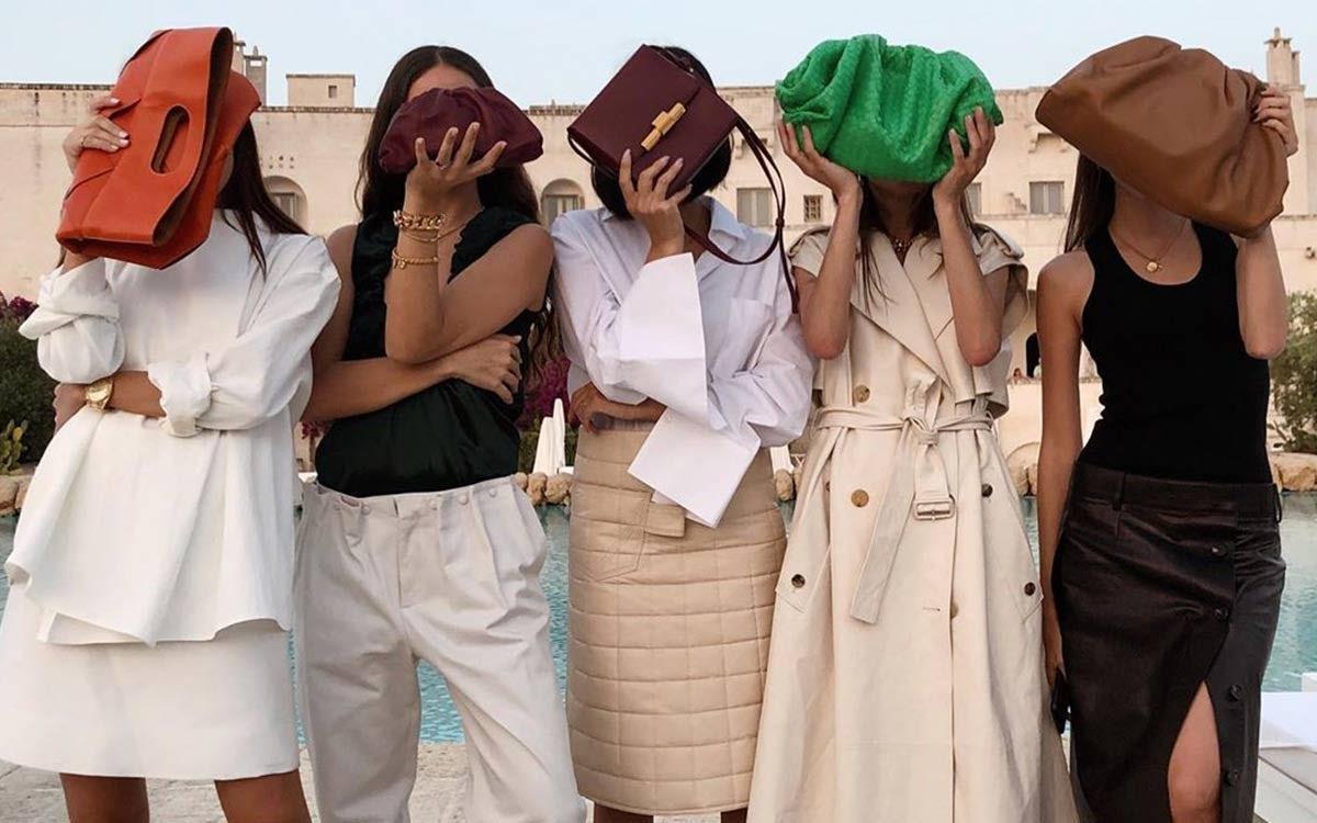 Influencers with Bottega Veneta handbags. @handinfire.