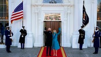 US President Joe Biden and US First Lady Jill Biden wave as they arrive at the White House in Washington, DC. Getty Images.