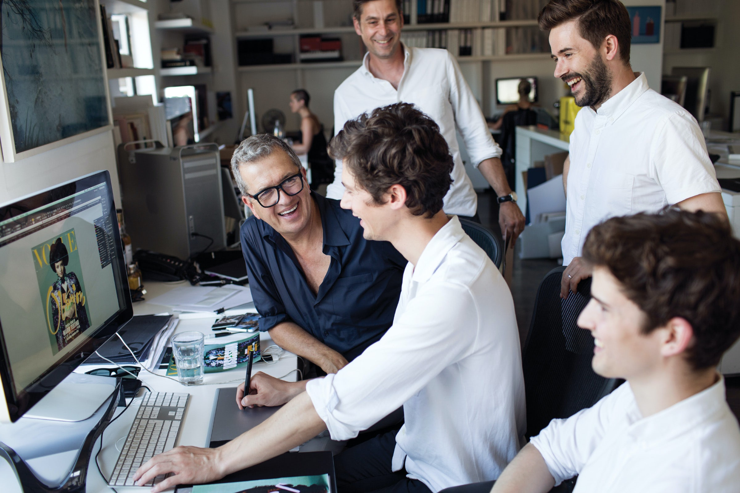Mario Testino working with employees on a Vogue cover