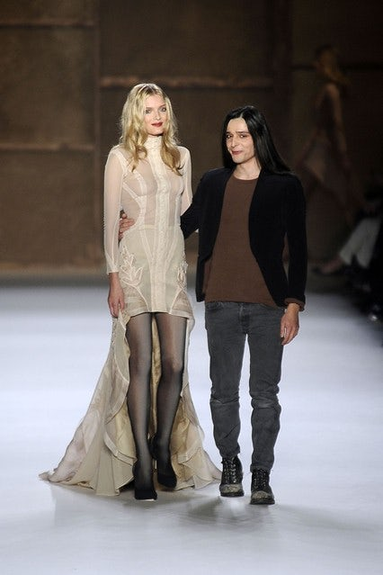 Olivier Theyskens and Lily Donaldson at the conclusion of Nina Ricci A/W 2009