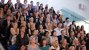 The crowd looks on at Fashion Pioneers with Natalie Massenet | Photo: Lawrence Randall