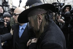 John Galliano arrives at the 3rd Arrondissement police station | Source: Daily Mail