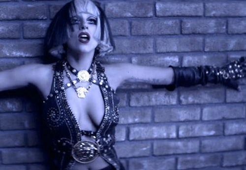 Gaga wears vintage Versace in her The Edge Of Glory video | Source: Guardian