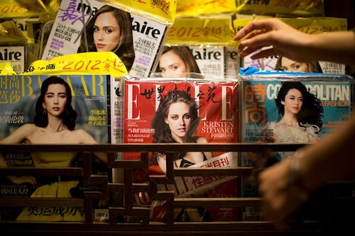 Chinese magazines by Sim Chi Yin | Source: NY Times