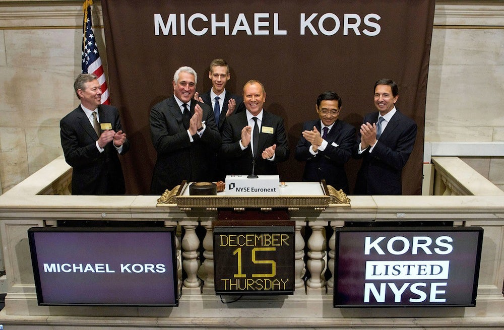 Michael Kors rings the opening bell at the New York Stock Exchange | Source: Courtesy NYSE Euronext