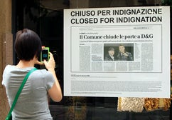 The sign declaring the Dolce & Gabbana stores in Milan are 'Closed for Indignation'   Source: Reuters