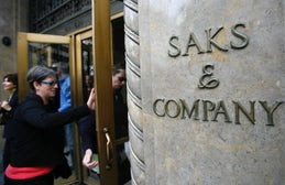 Shoppers walking into Saks Fifth Avenue | Source: Reuters