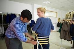 Measuring a shopper for fit | Source: Reuters