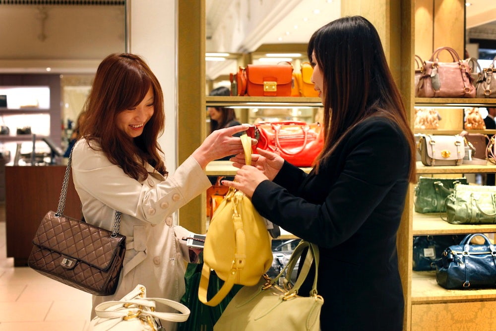 Chinese luxury shoppers | Source: Shutterstock