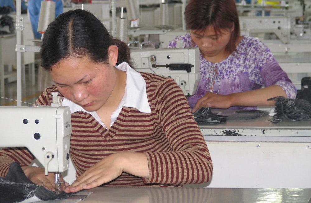 Women in a garment factory in China | Source: Shutterstock