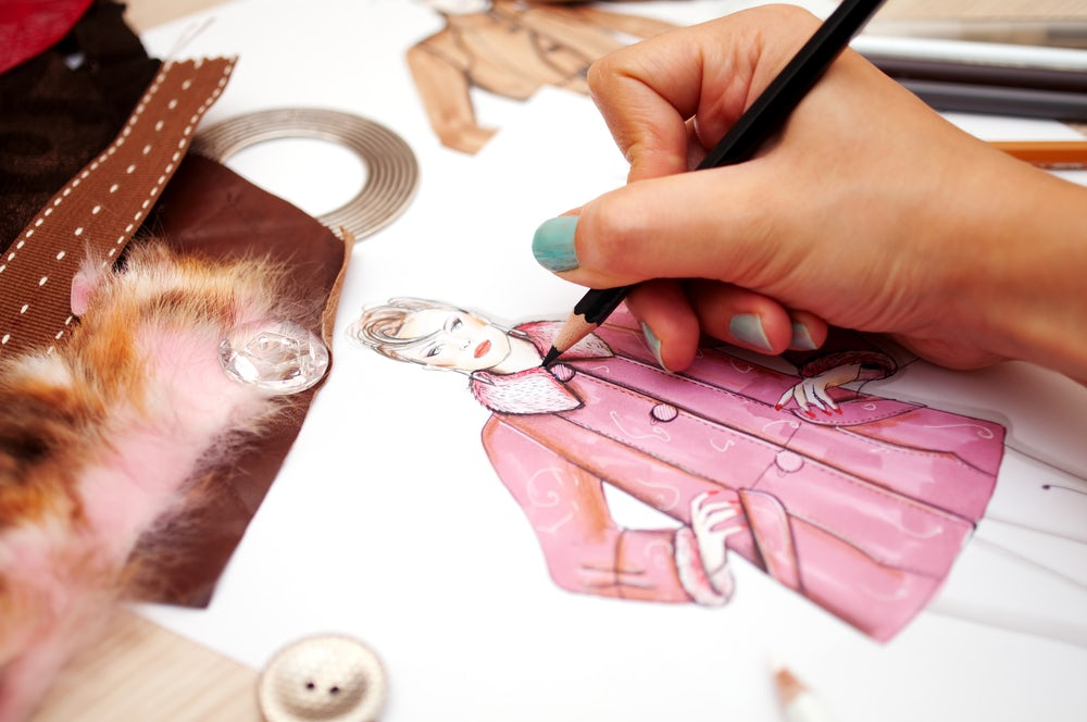 A designer sketching | Source: Shutterstock