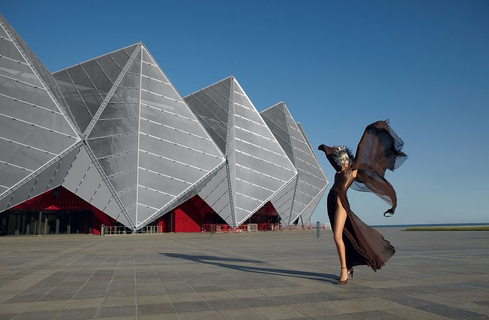 Model wearing Tilmann Grawe in front of Crystal Hall, Baku   Photo: Jacques Beneich